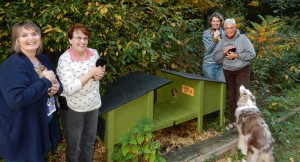Board Members (right to left) Debra, Carleen, and Sara delivered 2 huts to Mary, our first caregiver, and Vinny (the loyal cat watcher).